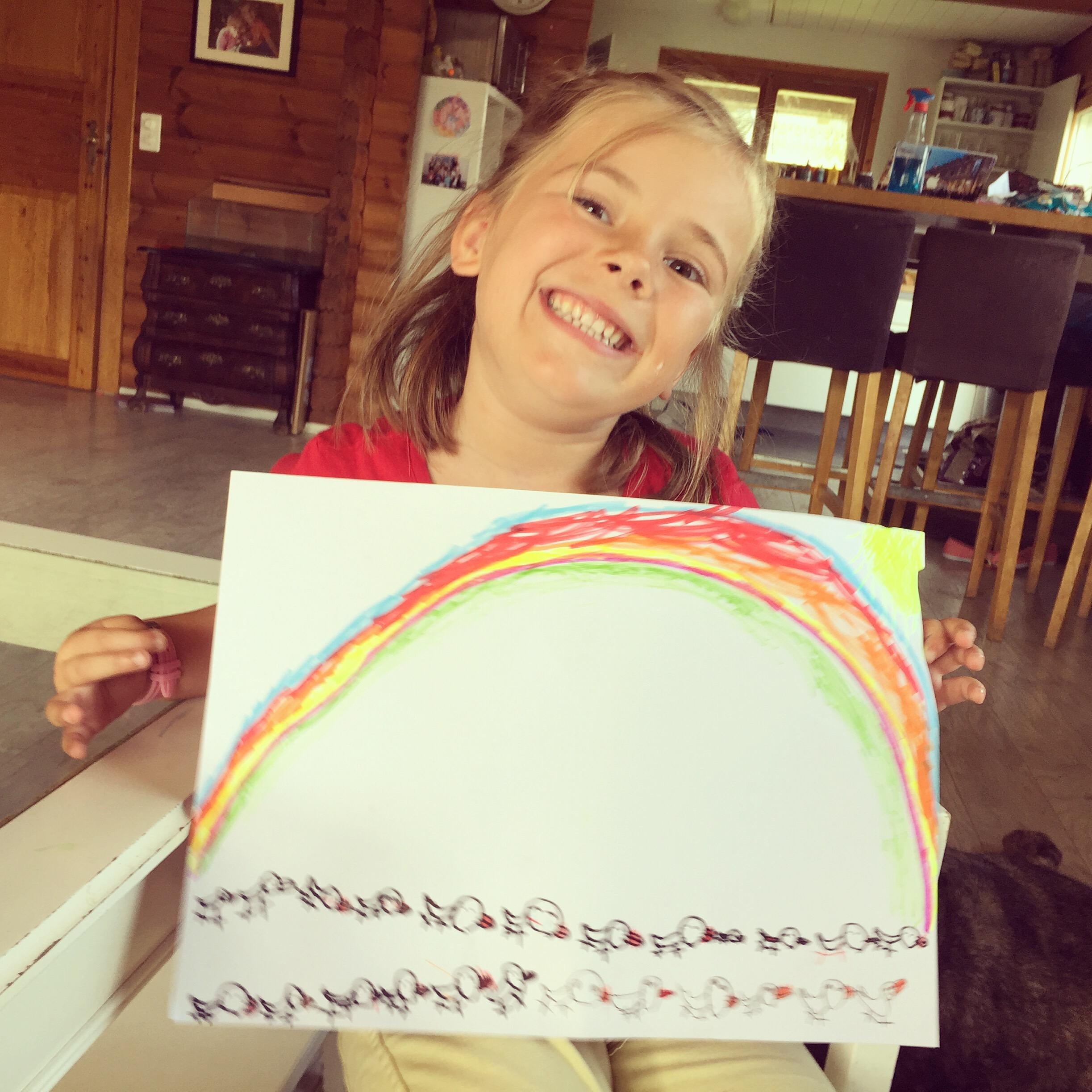 Dinsdag tekent Eva eendjes met een regenboog